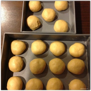 Place rolls in a (or two) greased baking pan, cover with plastic wrap and let sit until doubles in size (about 45 mins)Then brush with egg whites and bake at 375 degrees F for 30 minutes.