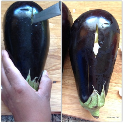 Wash the eggplant and tomatoes.  Then, make 2 inch slits (with a knife), lengthwise along the entire eggplant.  Peel the garlic cloves and cut in halves. Insert haves into a few of the slits in the eggplant.