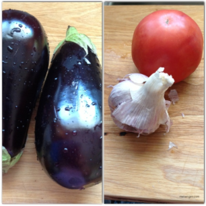 For this recipe you need 4 simple ingredients: Eggplant (I'm using two fairly large eggplants), 1 large tomato, about 4 cloves of garlic and about 5 heads of green onions (not pictured)