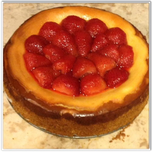 Using the strawberries you had set aside to cool, cover the top of the cheesecake.